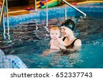 young mother  swimming... | Shutterstock . vector #652337743