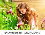 beauty girl outdoors enjoying... | Shutterstock . vector #652406443
