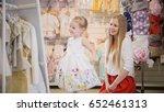 shopping for kids. mom admires... | Shutterstock . vector #652461313