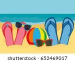 flip flops and sunglasses on... | Shutterstock .eps vector #652469017