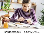 young woman eating bread with... | Shutterstock . vector #652470913