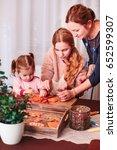 family decorating baked... | Shutterstock . vector #652599307