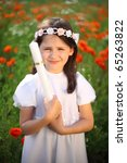 Girl child portrait (9-10) in his first holy communion, praying hands, rite of passage, clear conscience - stock photo