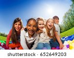 kids sitting on mat surrounded... | Shutterstock . vector #652649203