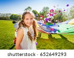 adorable girl playing parachute ... | Shutterstock . vector #652649293