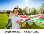 smiling boy playing active game ... | Shutterstock . vector #652649353