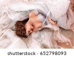 laying at long dress beautiful... | Shutterstock . vector #652798093