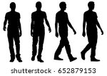 Silhouettes Of People Walking...