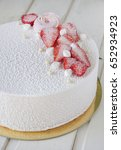 Small photo of White velour mousse cake with fresh strawberry