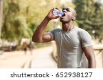 young black man drinking water... | Shutterstock . vector #652938127