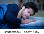 handsome young man in bed with... | Shutterstock . vector #652944157