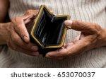 an elderly man holds an empty... | Shutterstock . vector #653070037