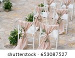 decorated chairs at the wedding ...   Shutterstock . vector #653087527