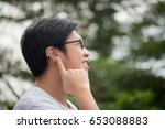 asian man with hearing aid... | Shutterstock . vector #653088883