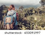 happy traveler with backpack... | Shutterstock . vector #653091997