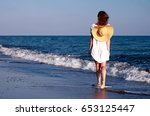 the girl with hat walking... | Shutterstock . vector #653125447