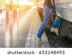 young tourist man feet step up... | Shutterstock . vector #653148493