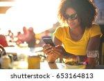 portrait of a cute girl sitting ...   Shutterstock . vector #653164813