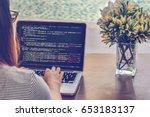 programmer typing new lines of... | Shutterstock . vector #653183137