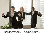 excited african and caucasian... | Shutterstock . vector #653200093