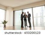 multi ethnic businesspeople... | Shutterstock . vector #653200123