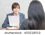 young asian woman arriving for... | Shutterstock . vector #653218513