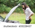 asian woman with a broken car... | Shutterstock . vector #653228437