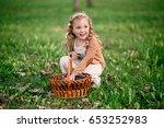 happy girl with rabbit in the... | Shutterstock . vector #653252983