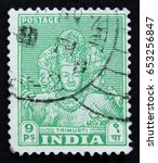 Small photo of MOSCOW, RUSSIA - APRIL 2, 2017: A post stamp printed in India shows The Trimurti - triad of deities, typically Brahma the creator, Vishnu the preserver, and Shiva the destroyer/regenerator, circa 1949