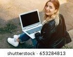 beautiful young woman working... | Shutterstock . vector #653284813