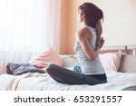 woman doing yoga exercise on... | Shutterstock . vector #653291557