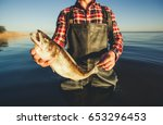one man   a fisherman standing... | Shutterstock . vector #653296453
