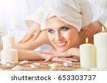 young woman having massage | Shutterstock . vector #653303737