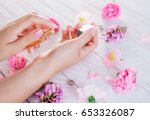 woman applying perfume on her... | Shutterstock . vector #653326087