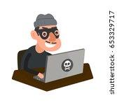 robber hacker with laptop... | Shutterstock .eps vector #653329717