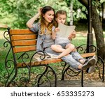 Mom and daughter on a bench...