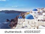 santorini blue dome churches on ...   Shutterstock . vector #653352037