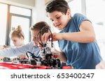 attentive young male technician ... | Shutterstock . vector #653400247