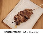 the grilled pork on the white... | Shutterstock . vector #653417317