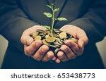 hands of business man holding a ... | Shutterstock . vector #653438773
