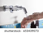 hand washing in the bathroom at ... | Shutterstock . vector #653439073