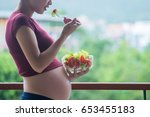 pregnant woman holding glass...   Shutterstock . vector #653455183