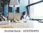 business lady sitting near the... | Shutterstock . vector #653550493