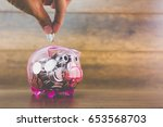 saving concept    coin in piggy ... | Shutterstock . vector #653568703