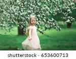 little girl is walking in an... | Shutterstock . vector #653600713