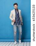 happy handsome man over blue... | Shutterstock . vector #653625133