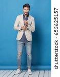 happy handsome man over blue... | Shutterstock . vector #653625157