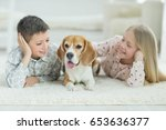 happy children with dog | Shutterstock . vector #653636377