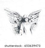 angel girl looks down ... | Shutterstock .eps vector #653639473