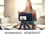 young woman making a vlog... | Shutterstock . vector #653656147